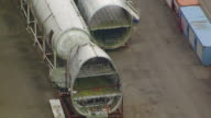 MS AERIAL ZO View of airplane fuselages and parts outside of Boeing Everett factory / Everett, Washington, United States