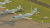 MS AERIAL View of airplanes parking in row on tarmac at Cessna Mid Continent Airport / Wichita, Kansas, United States