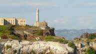 WS ZO AERIAL View of Alcatraz Island and prison complex to city skyline / San Francisco, California, United States