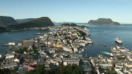WS View of Alesund city, harbor, mountains in Islands fjord / Alesund, Norway