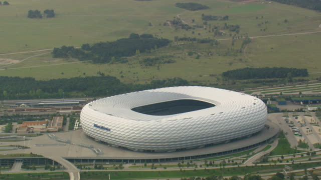 WS AERIAL View of Allianz arena stadium and road way with vehicle / Germany