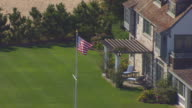 WS AERIAL POV View of American Flag at Katharine Hepburn House/ Old Saybrook, Connecticut, United States