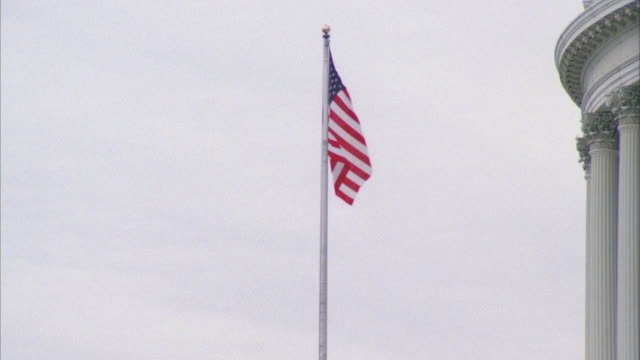 MS ZO View of american flag on capitol building / Washington DC, United States
