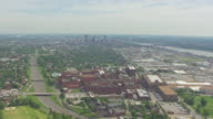 WS AERIAL View of Anheuser Busch brewery with city and river / St Louis, Missouri, United States