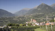 WS PAN View of apple plantation and mountain village / Schenna, Tyrol, Italy