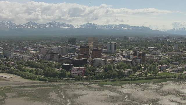 WS AERIAL View of approach to downtown buildings / Anchorage, Alaska, United States