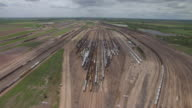 WS AERIAL TD View of Approaching to track high over trains at Bailey Train Yard / North Platte, Nebraska, United States