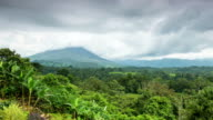WS T/L View of arenal volcano and jungle in morning mist with clouds moving / La Fortuna, Alajuela, Costa Rica
