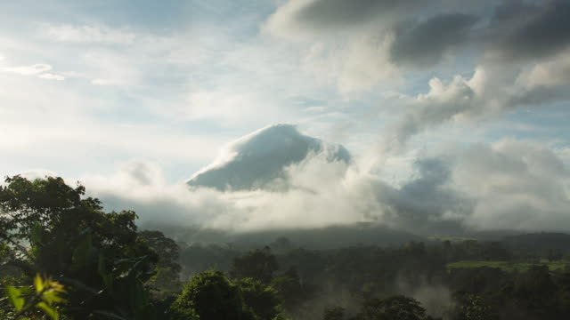 WS T/L View of arenal volcano in mist with clouds moving over / La Fortuna, Alajuela, Costa Rica