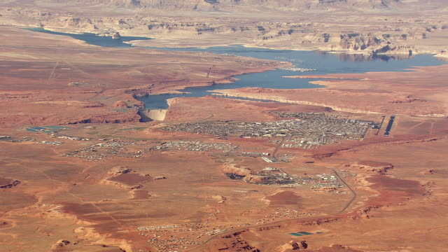WS AERIAL View of Arizona and Lake Powell with town / Arizona, United States