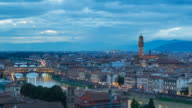 WS T/L PAN View of Arno River, Ponte Vecchio with florence cathedral   Il Duomo di Firenze at dusk / Florence, Tuscany, Italy