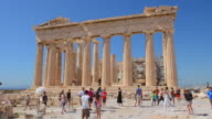 WS View of Athens Parthenon at Acropolis tourists crowds at ruins on this landmark building of history monument biilt in 447 BC / Athens, Greece