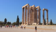 WS View of Athens ruins of famous Temple of Zeus pillars and historical monument landmark with tourist / Athens, Greece