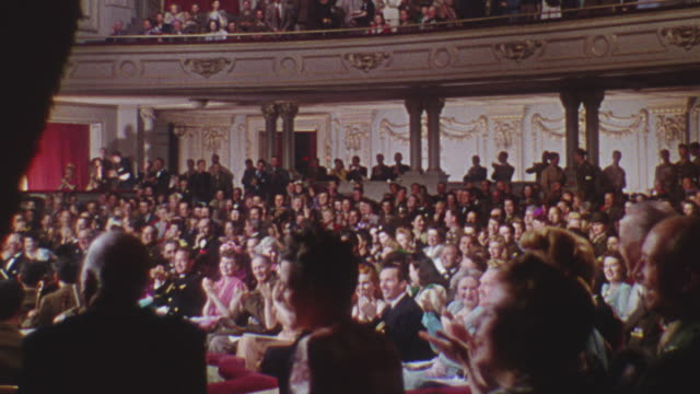 WS View of audience laughing in theatre
