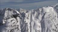 WS ZI ZO TD View of avalanche exploding through snowy ridge / Revelstoke, British Columbia, Canada