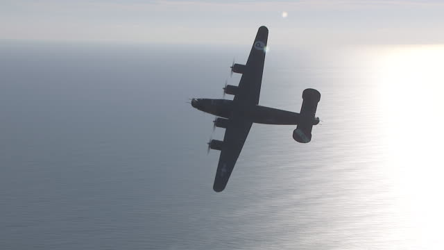 AERIAL WS View of B-24 Bomber Flying out at Sea / Florida, United States