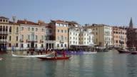 WS View of barge men's riding boats on Canal Grande near Santa Maria Della Salute / Venice, Veneto, Italy