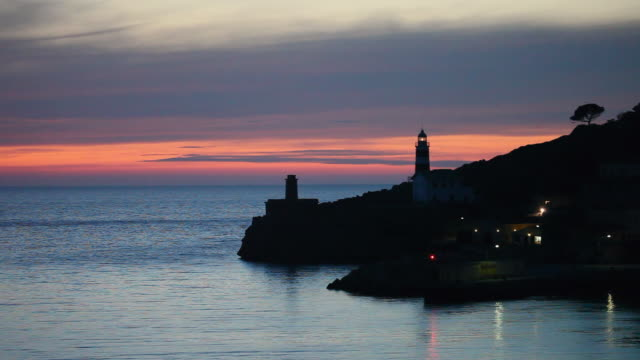 WS View of bay and lighthouse at sunset / Port de Soller, Mallorca, Baleares, Spain
