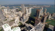 WS POV AERIAL View of bay and skyscrapers in downtown / Miami, Florida, USA