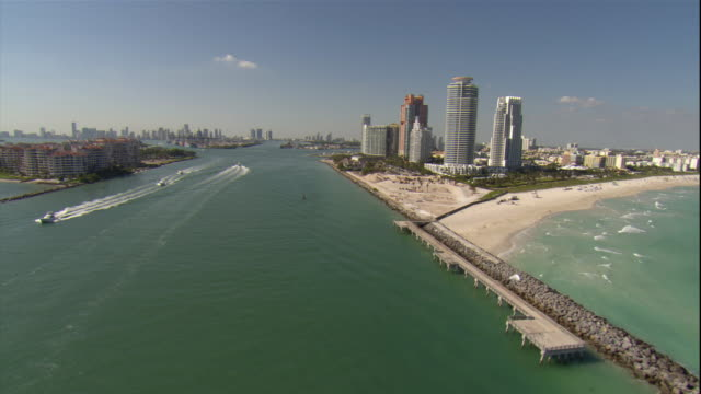 WS PAN POV AERIAL View of beach and cityscape with boats / Miami, Florida, USA