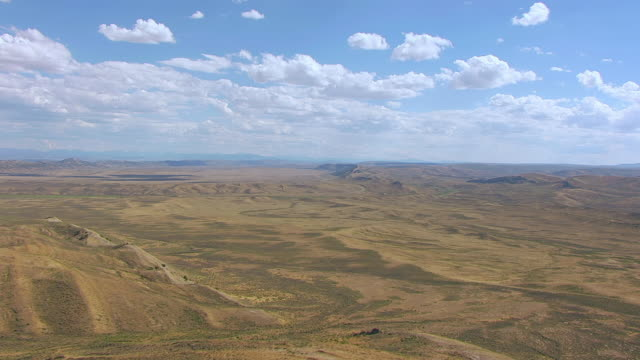 WS AERIAL View of Bell Butte landscape and desert / Wyoming, United States