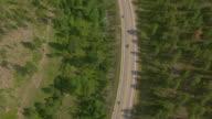 WS AERIAL View of bikers driving down highway 170 away / Sturgis, South Dakota, United States