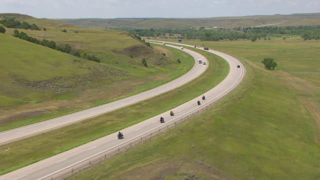 WS AERIAL TS View of bikers riding on Highway 90 heading west in Pennington County / Wasta, South Dakota, United States