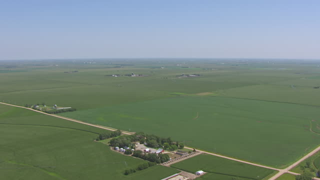 WS AERIAL TD View of Blue clear sky to green farmland southeast of Hastings / Nebraska, United States