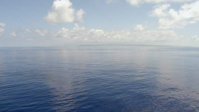 WS AERIAL View of blue ocean waters on island of Oahu / Hawaii, United States