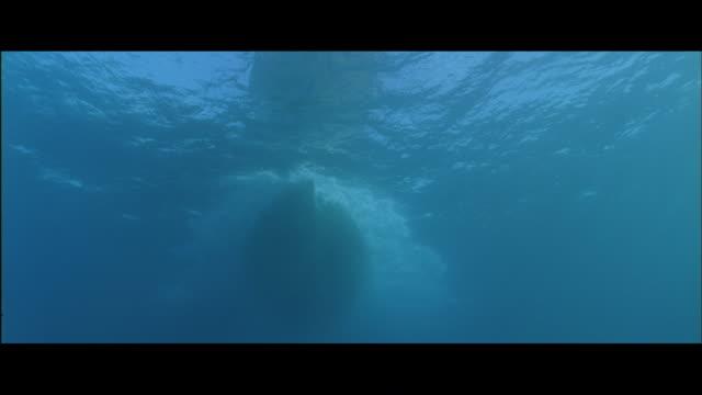 LA View of boat hull passing underwater