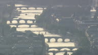 MS AERIAL TD View of boat passing under bridges over Seine backlit from east / Paris, France