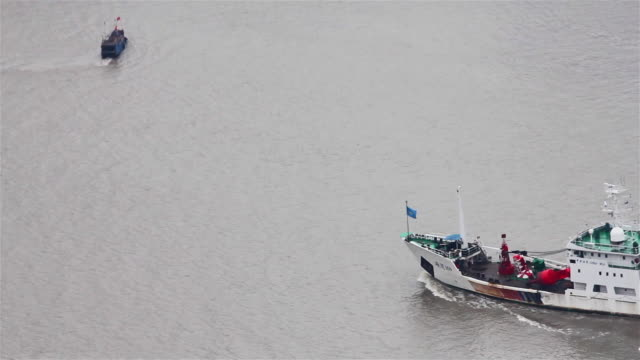 MS View of Boats travelling on Huangpu River / Shanghai,  China