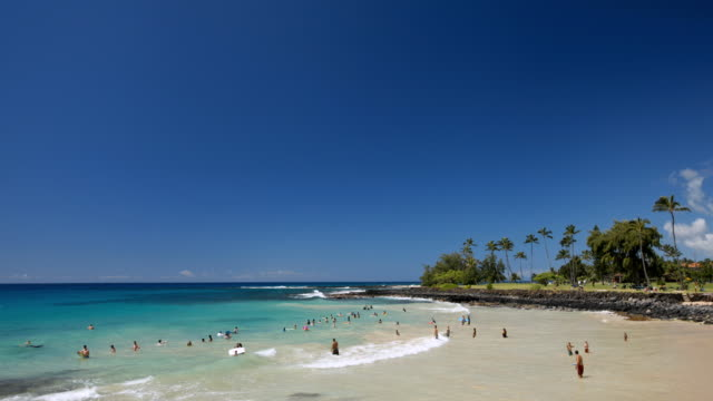WS T/L View of boogie boarders at Brennecke beach  / Poipu, Kauai, Hawaii, USA