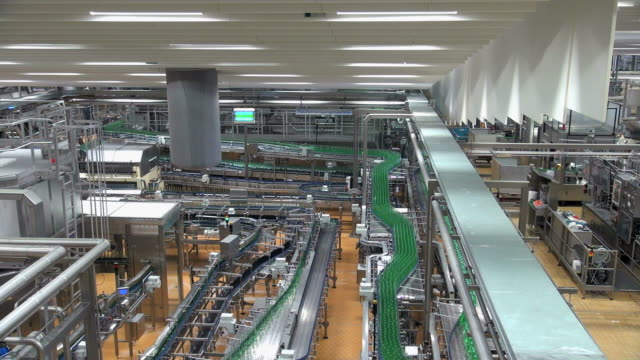 WS View of bottle moving in bottling plant at beverage industry / Gerolstein, Rhineland Palatinate, Germany