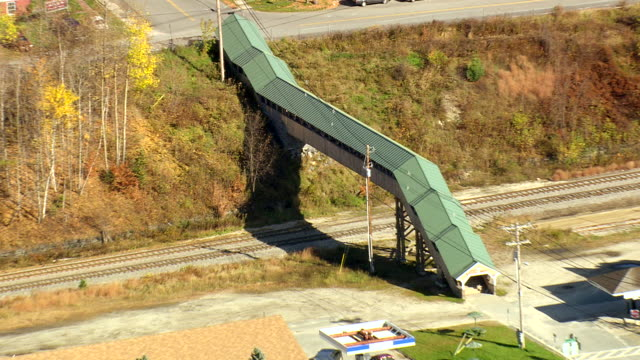 MS AERIAL TS View of bridge on railway track in small town / Vermont, United States