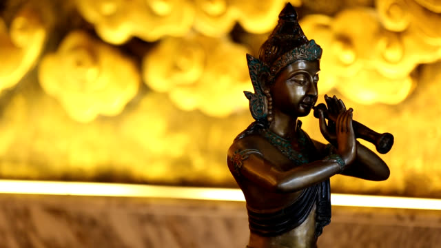View of bronze statue in Buddhist Temple