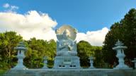 WS T/L View of Buddha statue and Stone Pagoda in Gwaneumsa Temple / Jeju, Jeju Island, South Korea