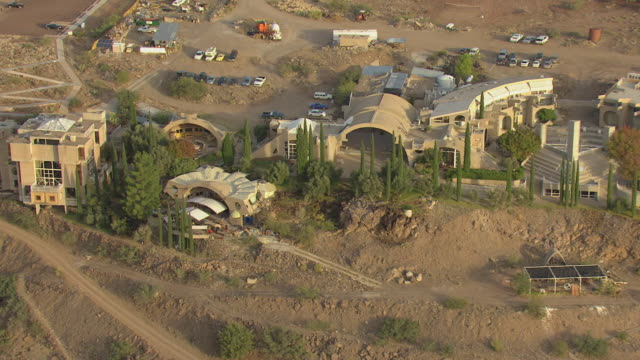 WS AERIAL View of building on outskirt of town / Arcosanti, Arizona, United States