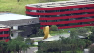 WS AERIAL View of building with flag moving on wind / Brasilia, Brazil