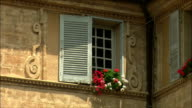 CU View of building with flowers on window sill / Aix-en-Provence, Provence, France