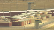 MS DS ZI AERIAL View of buildings and lookout towers and barbed wired fence at florence supermax prison / Colorado, United States