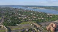 WS AERIAL POV View of buildings and Potomac River / Alexandria, Virginia, United States