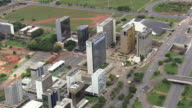 WS AERIAL View of buildings and traffic moving on street / Brasilia, Brazil