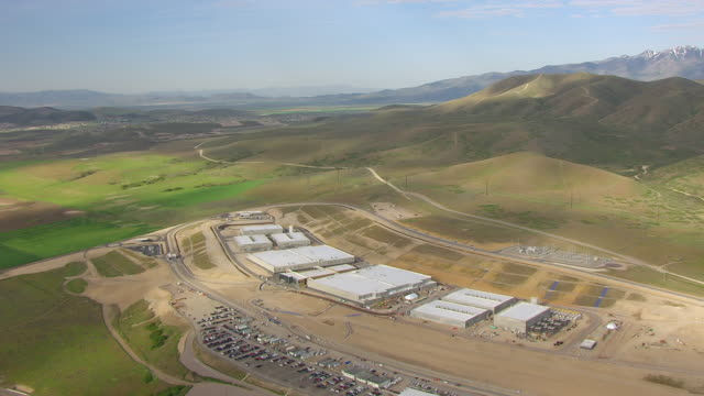 WS AERIAL View of buildings at NSA Utah data center with mountains / Utah, United States