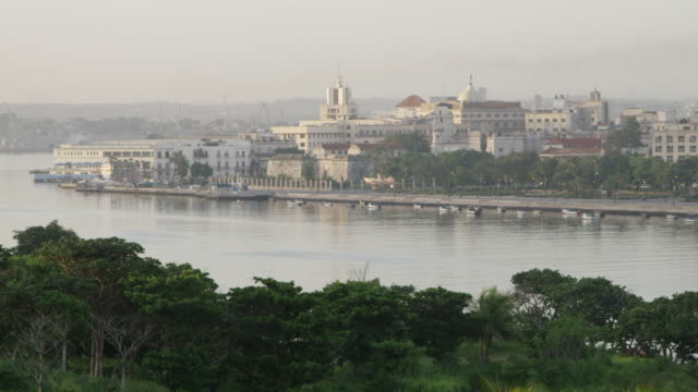WS View of buildings near canal de entrada and boats on canal / Havana, Cuba
