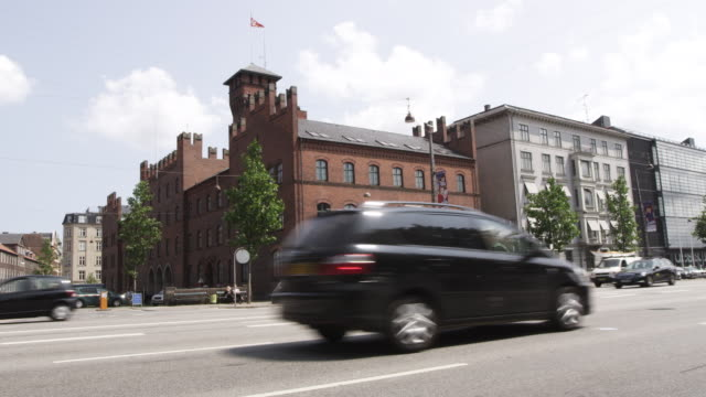 WS View of buildings near city hall and running vehicles on road / Copenhagen, Denmark