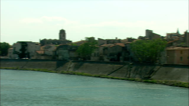 WS PAN View of buildings on riverbank / Arles, Provence, France