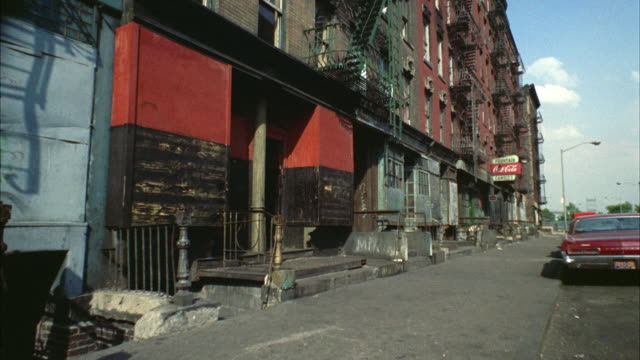 WS View of buildings with shops in slum area  / New York City, New York, USA