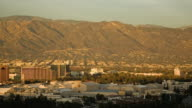 T/L, WS, HA, View of Burbank with Warner Bros studio sound stages, mountains in background, Universal City, California, USA