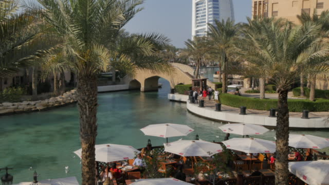 View of Burj Al Arab and cafes from Madinat Jumeirah, Dubai, United Arab Emirates, Middle East, Asia